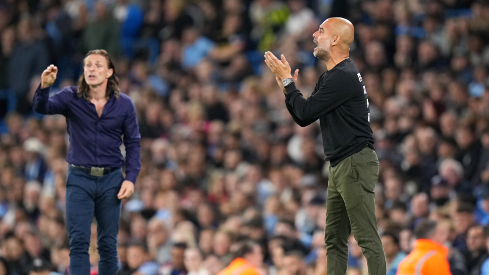 ENCOURAGEMENT  : Pep motivates the ranks from the side after Wycombe's opener