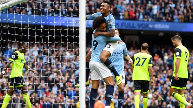 HIT FOR SIX : Gabriel Jesus and Leroy Sane celebrate one of City's six goals against Huddersfield Town