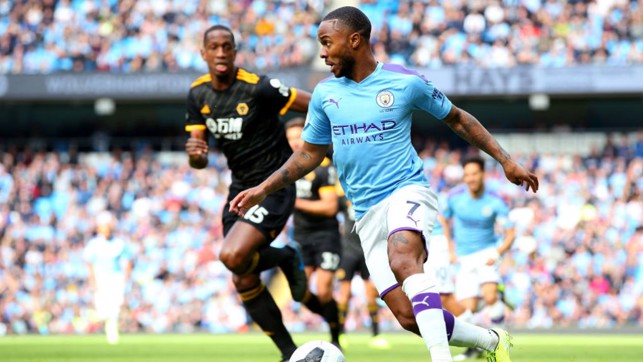 DRIBBLE : Sterling looks to unlock a rigid Wolves defence.