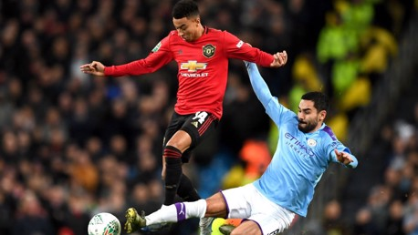 SILKY ILKAY: Gundogan wins the ball back fairly from Lingard.