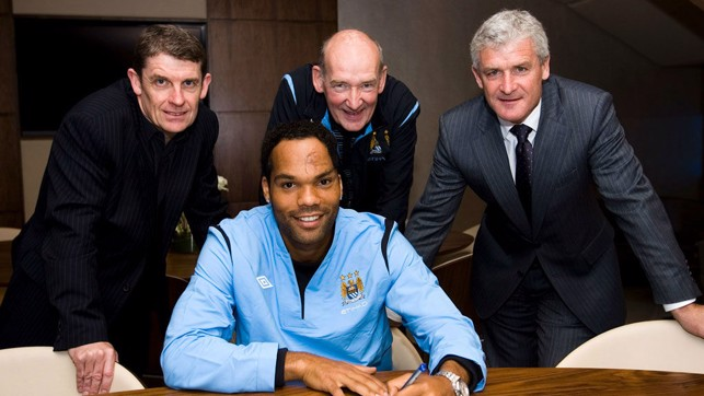 SIGN LANGUAGE : Flashback to 2009 and Bernard looks on along with Brian Marwood and former manager Mark Hughes as Joleon Lescott signs for City