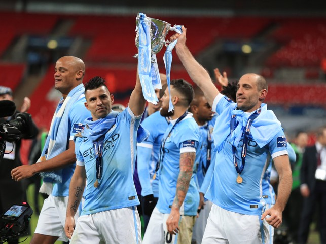 GET IN : Aguero celebrates the Capital One Cup win with Pablo Zabaleta