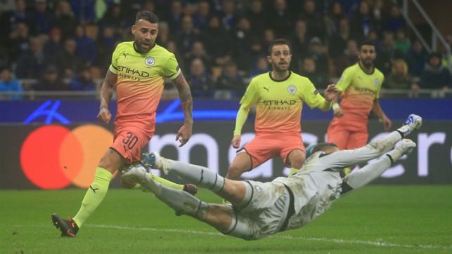 AT FULL STRETCH : Atalanta keeper Pierluigi Gollini dives to punch clear as City sweep forward