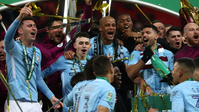 ALL TOGETHER NOW : Laporte and the Blues joyfully celebrate after lifting the 2018 Carabao Cup