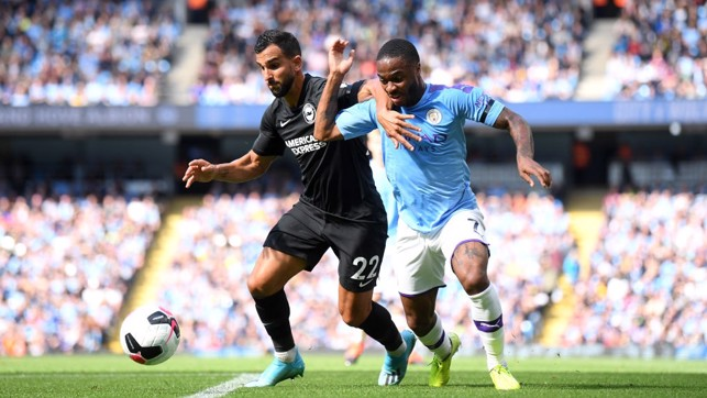 PROBING : Raheem Sterling races down the left flank.