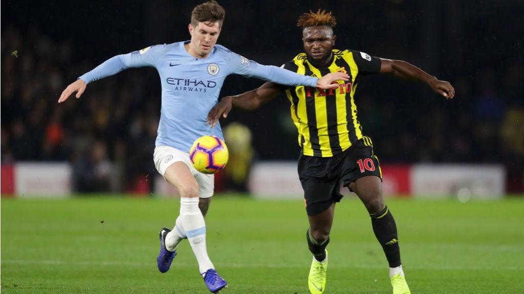 NO ENTRY : John Stones looks to close down Watford's Isaac Success
