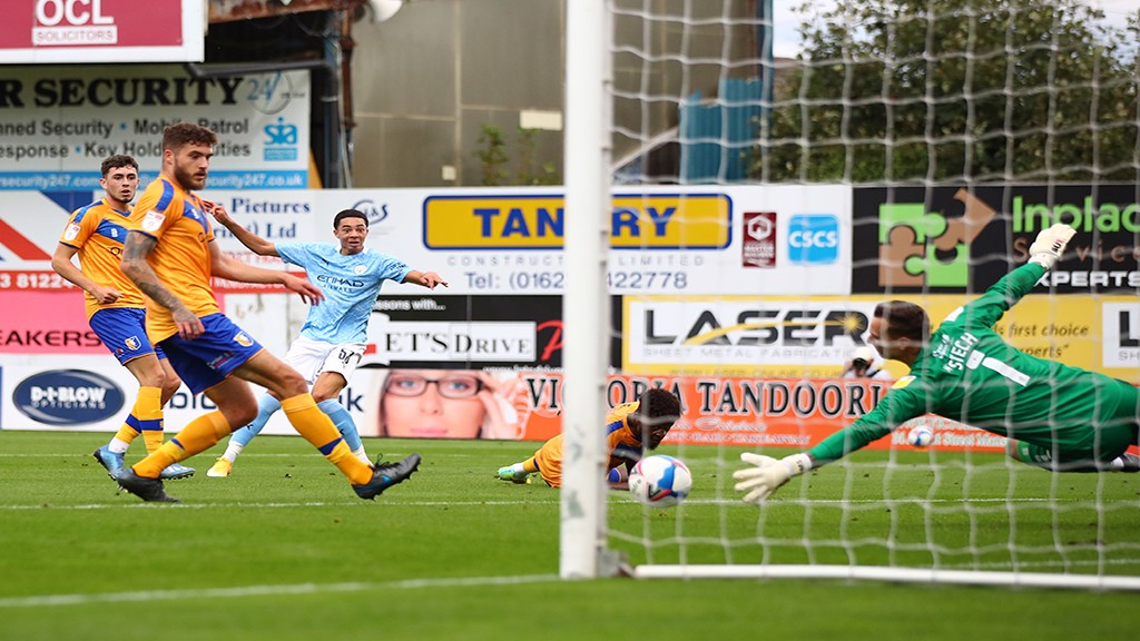 SO CLOSE: Sam Edozie is denied by the Mansfield keeper