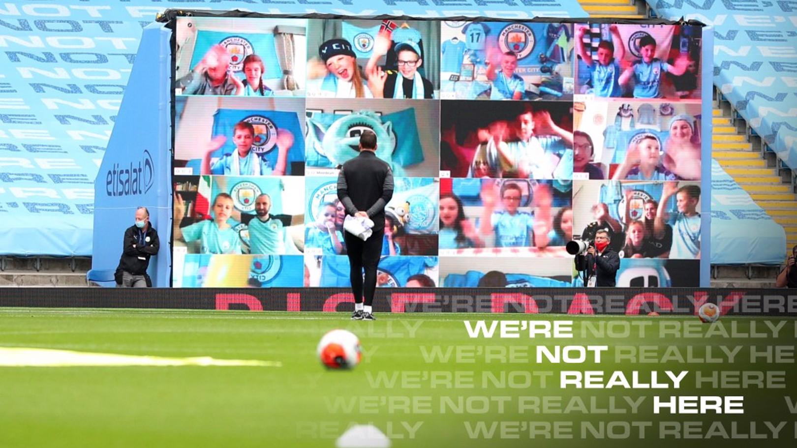 Competition winners take over Etihad Stadium fan wall