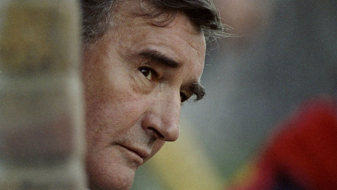 VISION ON: An atmospheric picture of Malcolm looking on from the dugout