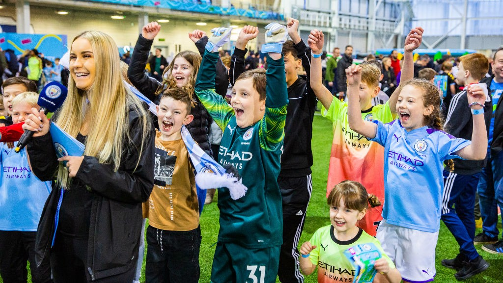 ALL SMILES : Just some of the happy youngsters at today's City Fanzone event