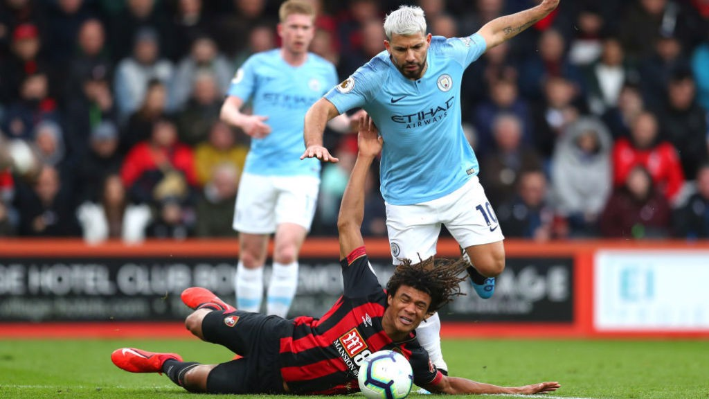 ACTION STATIONS: Nathan Ake goes crashing as he fends off Sergio Aguero
