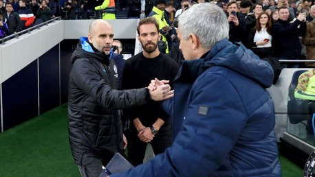 GAFFERS: Guardiola and Mourinho share a handshake ahead of kick-off.