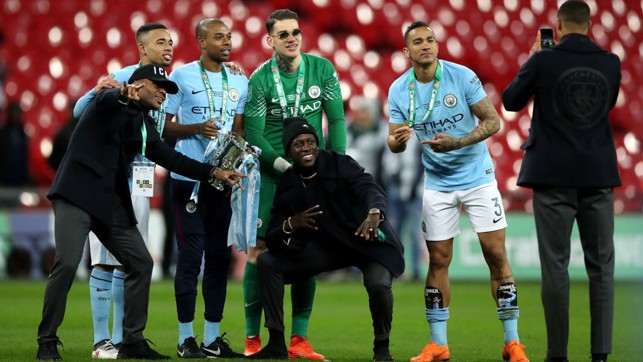 CARABAO CUP SUCCESS : Although he was injured for the final, Raheem poses with his teammates and the trophy.