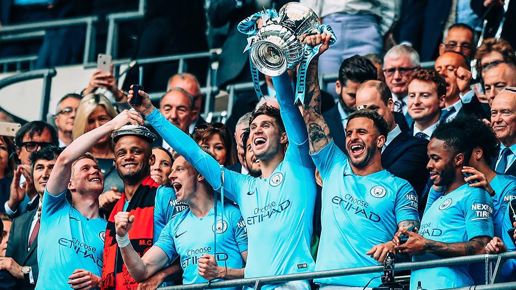 WINNERS : Stones leads the celebrations at Wembley last month