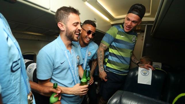 CABIN FEVER : Bernardo Silva, Danilo and Ederson just can't contain their joy
