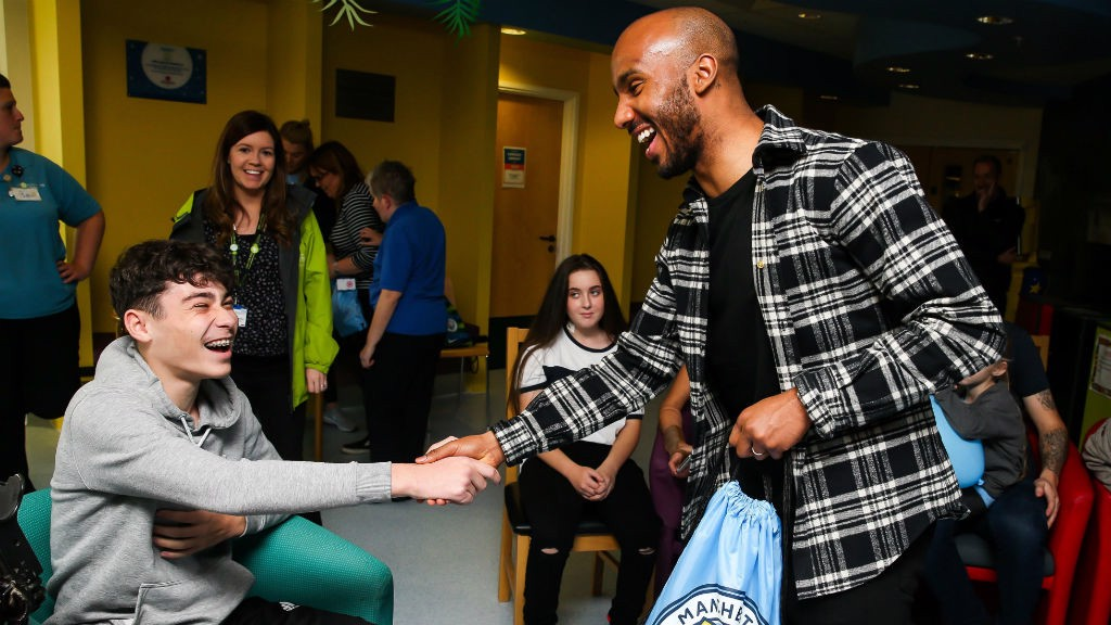 AB FAB : Fabian Delph helped put a big smile on this brave youngster's face during his visit to the Royal Manchester Children's Hospital