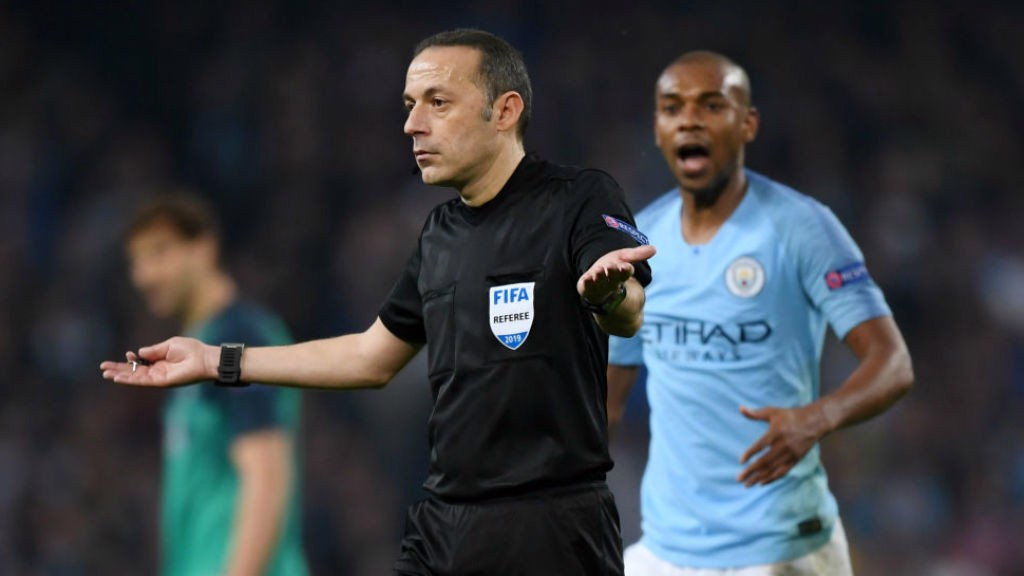 SHATERING BLOW : Referee Cuneyt Cakir signals offside for Raheem's late, late effort after consulting VAR