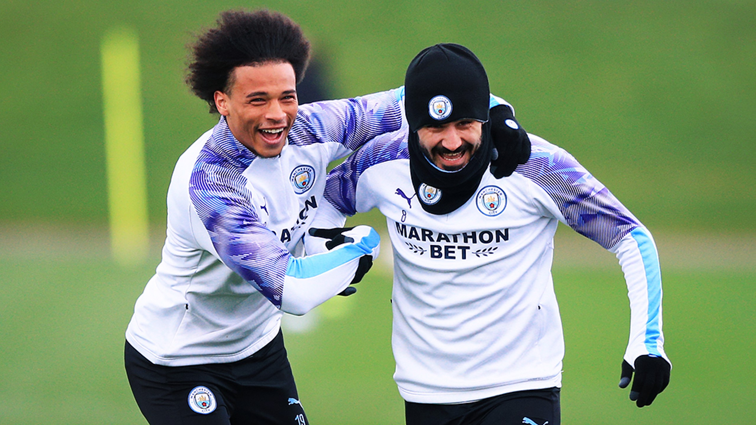 GOTCHA: Leroy Sane catches Ilkay Gundogan.
