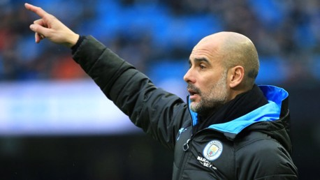 PEP TALK: Guardiola points out some adjustments from the sideline.