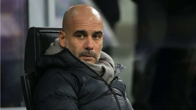WATCHING BRIEF : Pep Guardiola looks on as the action gets underway at the San Siro