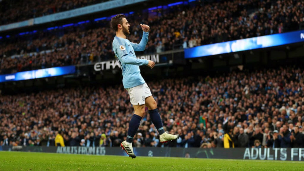 SILVA SHINES : Bernardo celebrates putting City 1-0 with a close-range strike