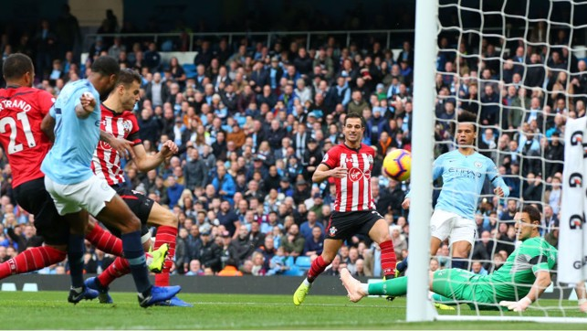 OPENING TIME : Wesley Hoedt deflects Leroy Sane's shot into the Southampton goal
