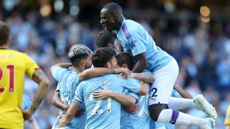 SUNSHINE BOYS: The City players celebrate after Mahrez's strike