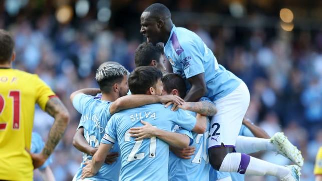SUNSHINE BOYS : The City players celebrate after Mahrez's strike