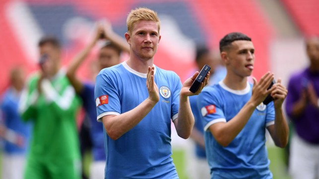 MASTER AND APPRENTICE : Kevin de Bruyne and Phil Foden salute City's supporters at Wembley.