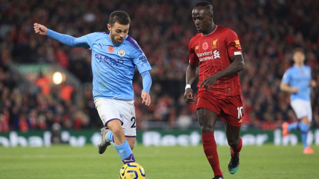 HEAD TO HEAD : Bernardo drives at the Reds' defence after Liverpool took an early lead through Fabinho.