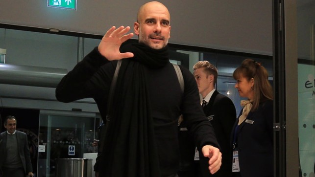 SMILE AND WAVE : The boss looks happy as he arrives at the Etihad.